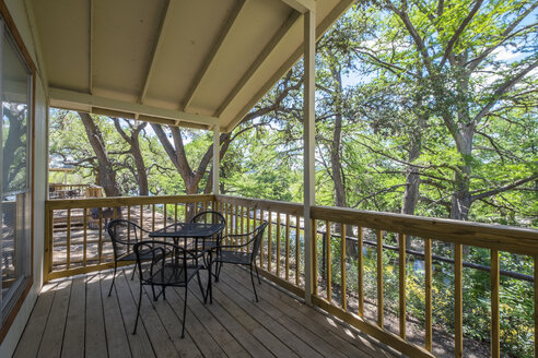 USA, Texas, Back porch of vacation home at the Frio River - ABAF001379