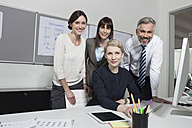 Germany, Munich Collegues in office working together - RBYF000539