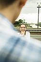 Young teenage girl photographing boyfriend - UUF001081