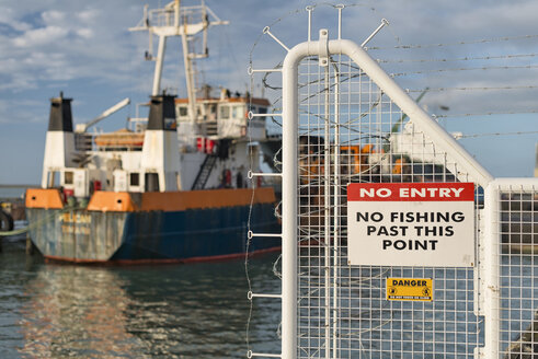 New Zealand, Nelson, fence with a no entry sign and a ship in the harbour - SHF001493