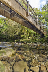 New Zealand, Tasman, Golden Bay, Takaka, wooden bridge over a stream along the Pupu Hydro Walkway - SHF001476