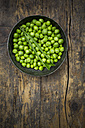 Green peas and peapod in a bowl - LV001471