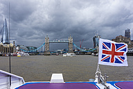 England, London, Southwark, view to the Tower Bridge with blowing Union Jack in the foreground - WEF000158