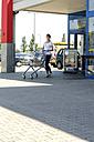 Young woman pushing shopping cart - GDF000336