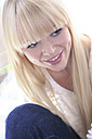 Portrait of smiling young woman - VTF000301