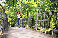 Woman making yoga exercise in a park - VTF000307