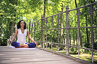 Woman making yoga exercise in a park - VTF000306