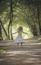 Little girl dancing on forest track - MW000052