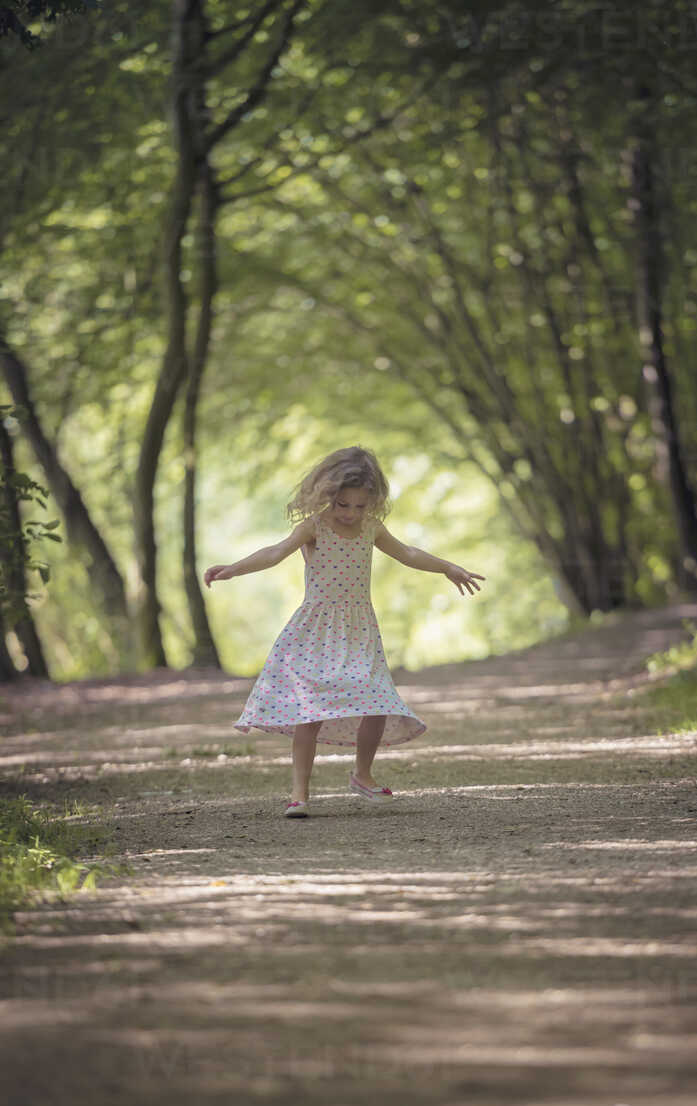 Little girl dancing on forest track - MW000052 - Martin Wimmer/Westend61
