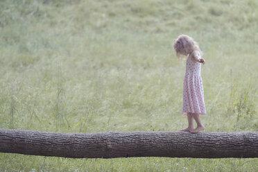 Germany, Bavaria, Girl is balancing on tree trunk - MW000054