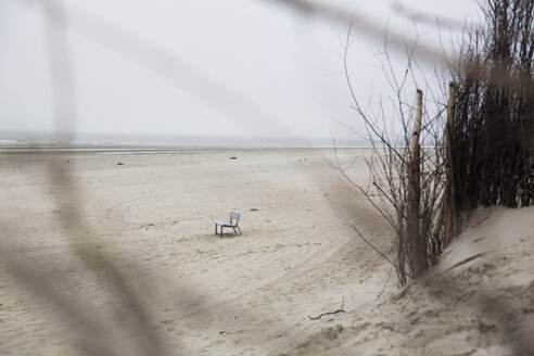 Germany, Lower Saxony, East Friesland, Langeoog, bench standing on the beach - JATF000742