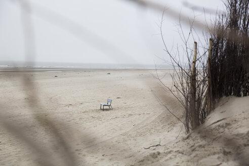 Germany, Lower Saxony, East Friesland, Langeoog, bench standing on the beach - JATF000742