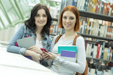 Two students in a university library - WESTF019734