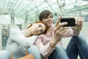 Couple taking self portrait - WESTF019741