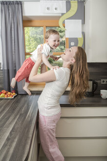 Mother with baby boy in kitchen - VTF000331