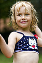 Portrait of smiling little girl wearing bikini top - JFE000417