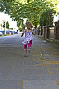 Little girl running on walkway - JFEF000418