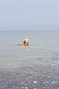 Germany, Schleswig-Holstein, Kiel, little girl bathing in the Baltic Sea - JFEF000425