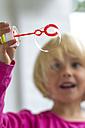 Little girl making soap bubble - JFEF000432