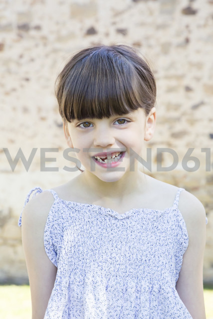 Portrait of smiling little girl with tooth gap - LVF001498