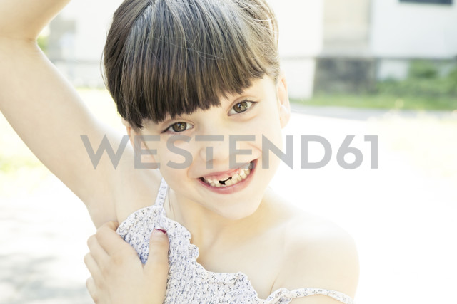 Portrait of smiling little girl with tooth gap making a face - LVF001505