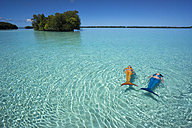 Palau, two young women in mermaid costume swimming in a lagoon - JWAF000106