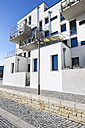 Germany, Hesse, Frankfurt Riedberg, view to modern multi-family house with balconies, partial view - JWAF000123