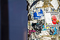 Germany, Berlin, Kreuzberg, old placards fixed on street lamp, partial view - BIG000015