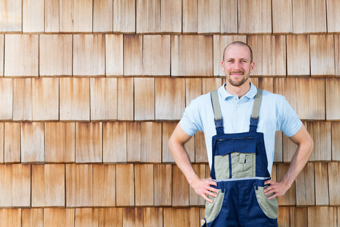 Confident craftsman at wooden wall - FKCF000001