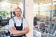 Confident craftsman at production hall - FKCF000023