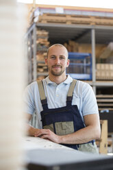 Smiling craftsman on shop floor - FKCF000069