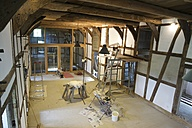 Germany, North Rhine-Westphalia, renovating walls in a hall of a half-timbered house farm house - HAW000388