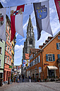 Germany, Baden-Wuerttemberg, Constance district, Constance, Old town, Pedestrian area, Minster tower and flags with historical emblems - EL001098