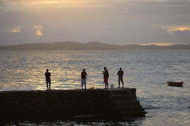 Brazil, Salvador da Bahia, Barra, four anglers at Porto da Barra by twilight - FLK000359