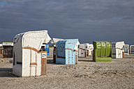 Germany, Lower Saxony, East Friesland Norddeich, hooded beach chairs - WIF000874