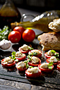 Slices of mozzarella cheese, tomatoes and basil herb - MAEF008680