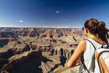 USA, Arizona, young woman enjoying the view at Grand Canyon - MBEF001083