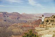 USA, Arizona, man enjoying the view at Grand Canyon - MBEF001087
