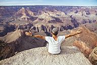 USA, Arizona, man enjoying the view at Grand Canyon, back view - MBEF001090