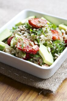 Bowl of quinoa strawberry salad with spinach and avocado - HAWF000377