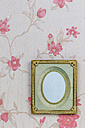 Empty picture frame on wallpaper with pink floral design - EJWF000410