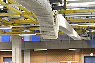 Conveyor belt with printed newspapers in a printing shop - SCH000344