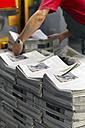 Employee in a printing shop preparing shipment - SCH000349