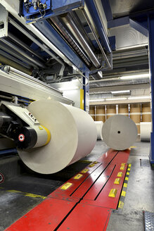 Presses with rolls of paper in a printing shop - SCH000362