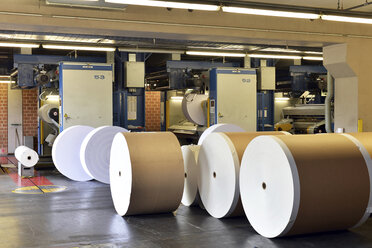 Presses with rolls of paper in a printing shop - SCH000367