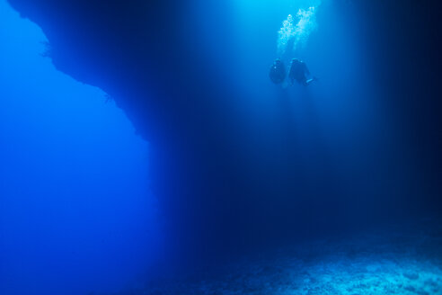 Palau, Pacific Ocean, two scuba divers in underwater cave - JWAF000153
