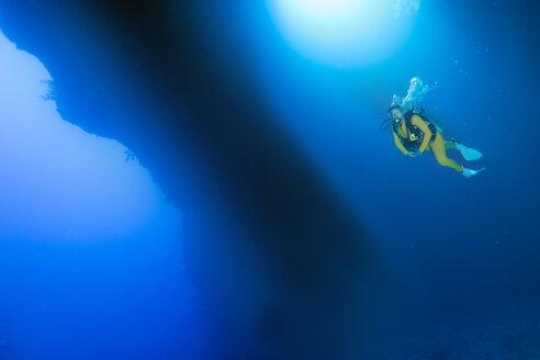 Palau, Pacific Ocean, scuba diver in underwater cave - JWAF000154