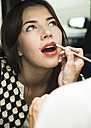 Female visagiste applying lipstick on young woman's lips - UUF001325