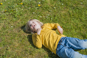Laughing boy lying in meadow - MJF001317