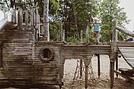 Little boy standing on wooden playground equipment - MF001153